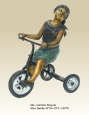Girl on Tricycle bronze sculpture