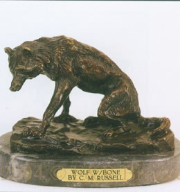 Wolf with Bone bronze by Charles Russell