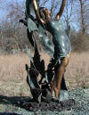 Lady with Dolphin Jumping Overhead bronze sculpture