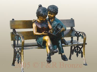 Boy and girl bronze statue