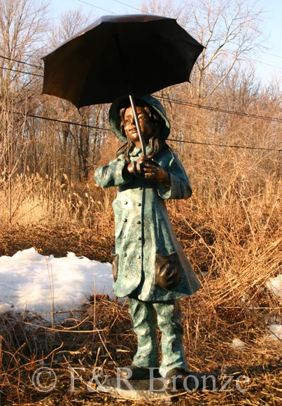 girl holding umbrella bronze