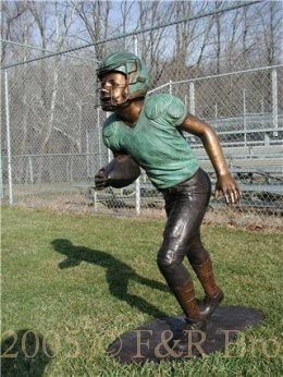 Boy Running With Football bronze statue