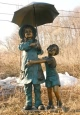 Boy & Girl with Umbrella bronze statue