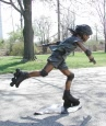 Girl Rollerblading bronze sculpture