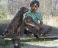 Girl with Dogs on Bench bronze statue