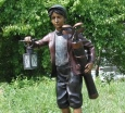 Caddy Boy bronze statue