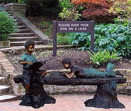 Boy and Girl Reading on Log Bench Bronze Statue
